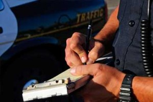 Police writing a traffic ticket | The Nelson Law Firm